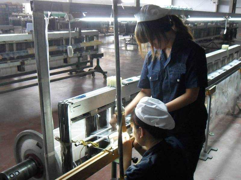 Two females workers are working in the workshop.